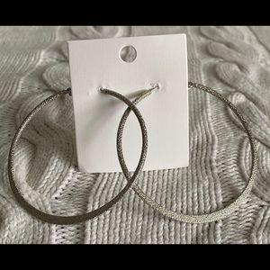 Jewelry - Large, silver tone hoop earrings. NWT.